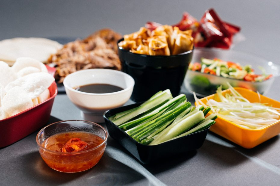 Chinese Food in Assortment of Small Serving Dishes