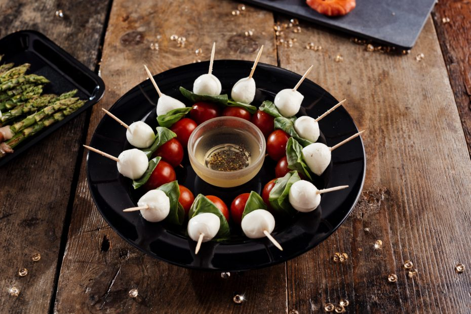 Party Food on a Black Wide Rim Plate
