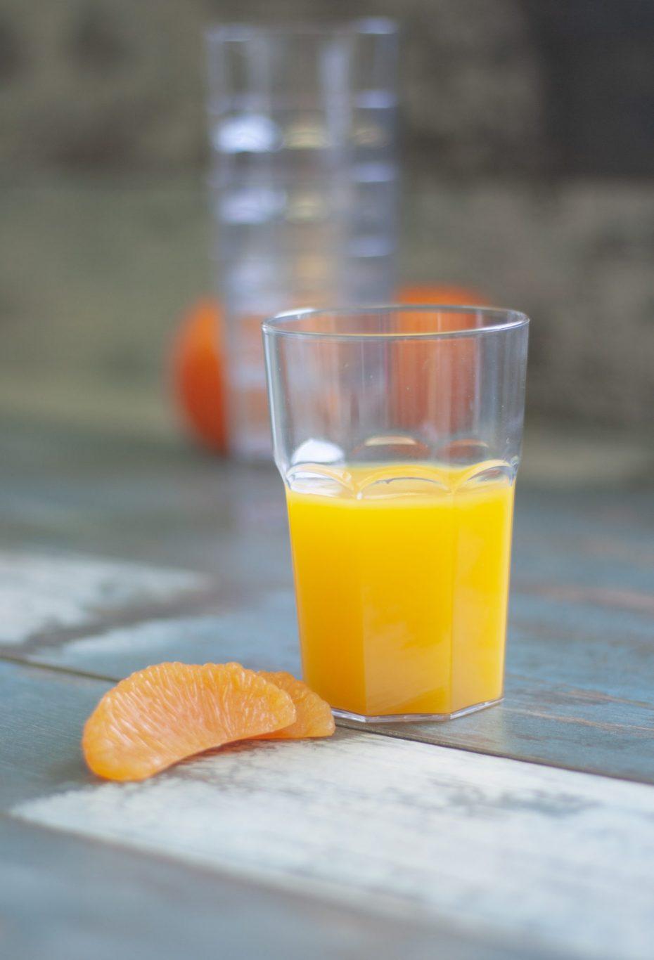 Clear Economy Tumbler with Orange Juice