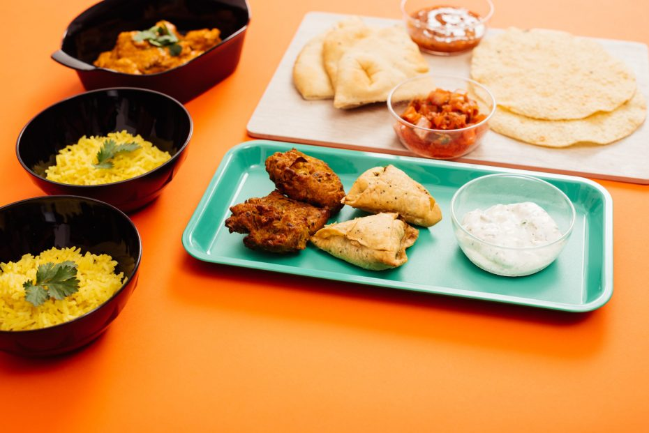 Indian food served on food platters and individual rice bowls