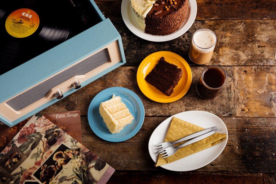 White Chocolate Sponge Cake on a Blue Plate with Late Coffee