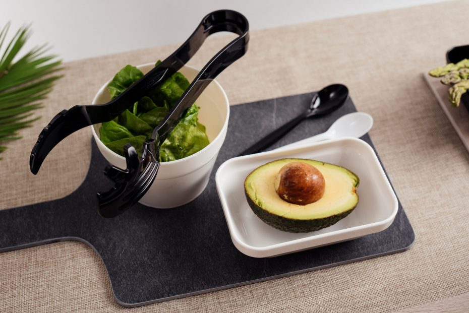 Avocado in a small white rectangular bowl on slate chopping board