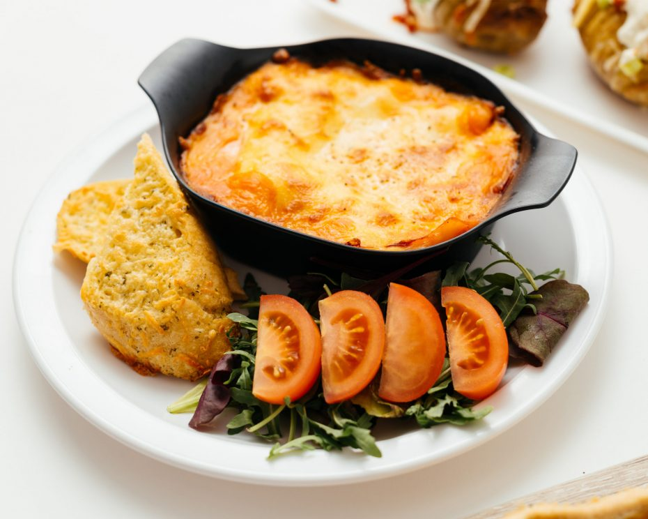 Lasagne in a black individual portion dish