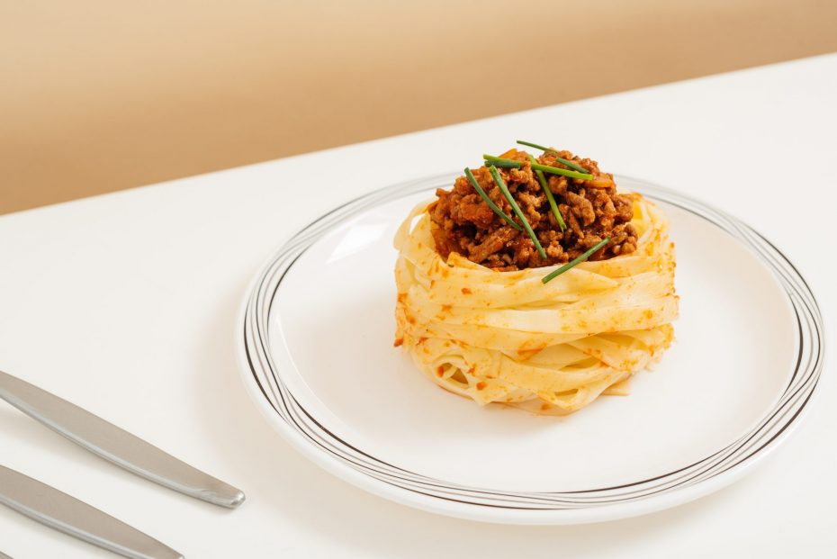 Spaghetti Bolognese on a Black & Grey Swirl Plate
