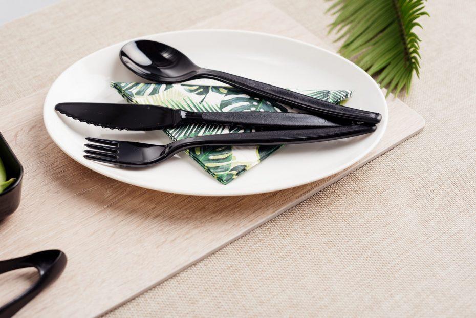 Black Cutlery on an Oval Plate