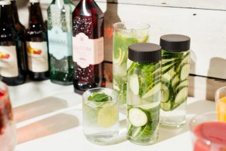 Caraffe and water bottles with cucumber infused water