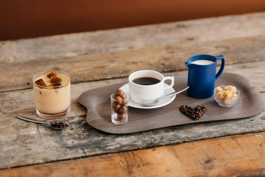 Coffee and Milk Jug on a Grey Wood Tray