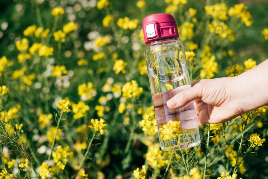 Water Bottle with Pink Sports Cap in a Field