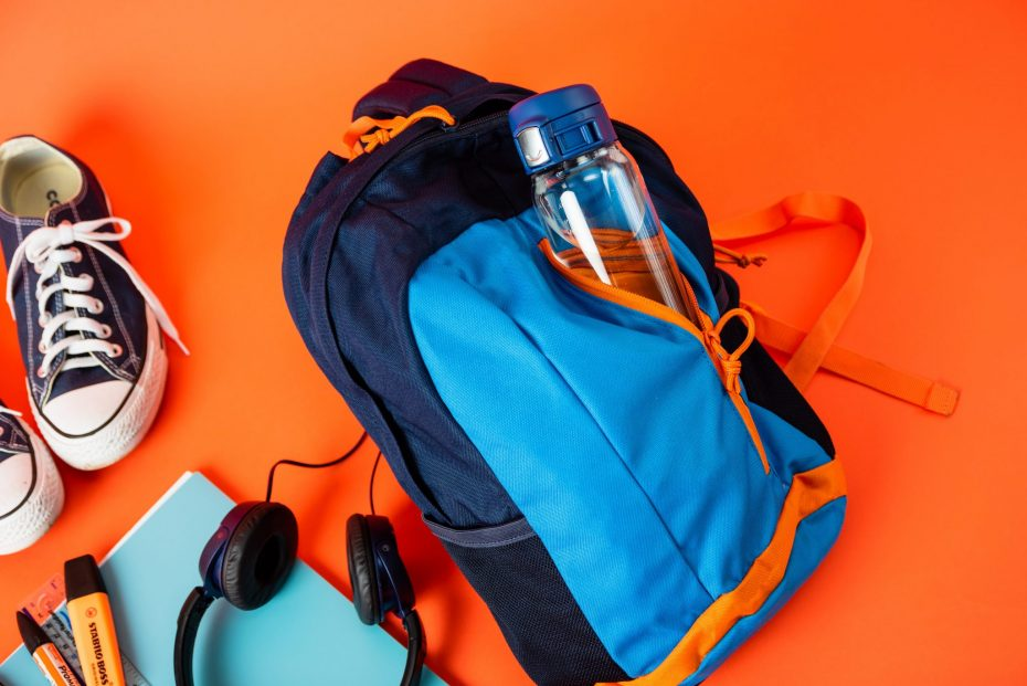 Water Bottle with Blue Sports Cap in a Backpack