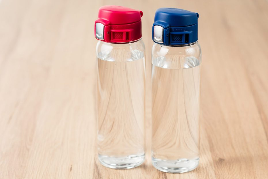 Water Bottles with Pink and Blue Caps