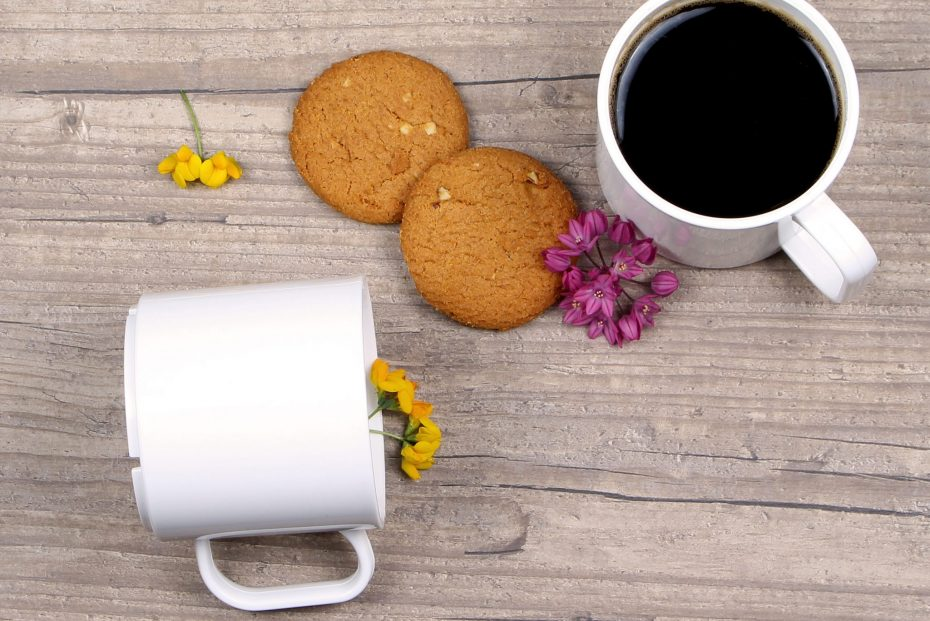 Black Coffee in a White Mug with Biscuits