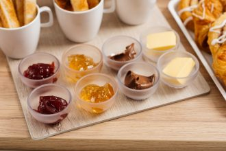 Breakfast Buffet with Jams, Butter and Chocolate Spread in Dip Bowls
