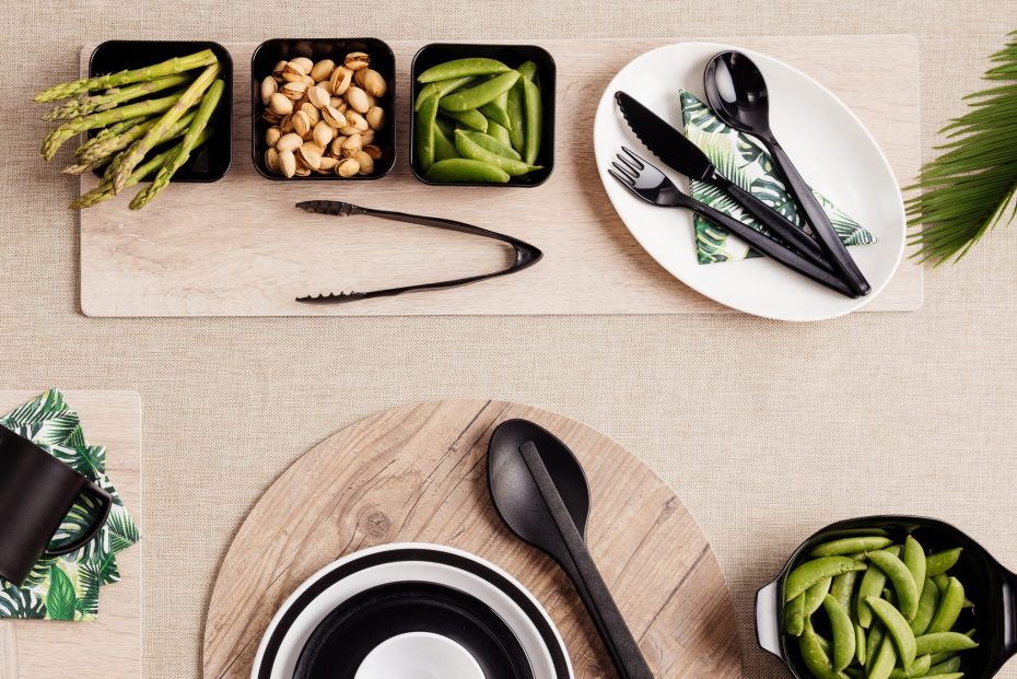 Black Tableware and S-Planks on a Dinner Table