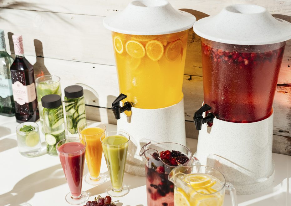 White Drink Dispensers with fresh fruit jucies